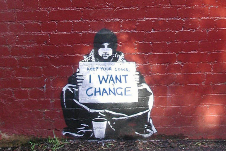"Street art showing a man holding a sign that says, ""Keep your coins. I want change"""